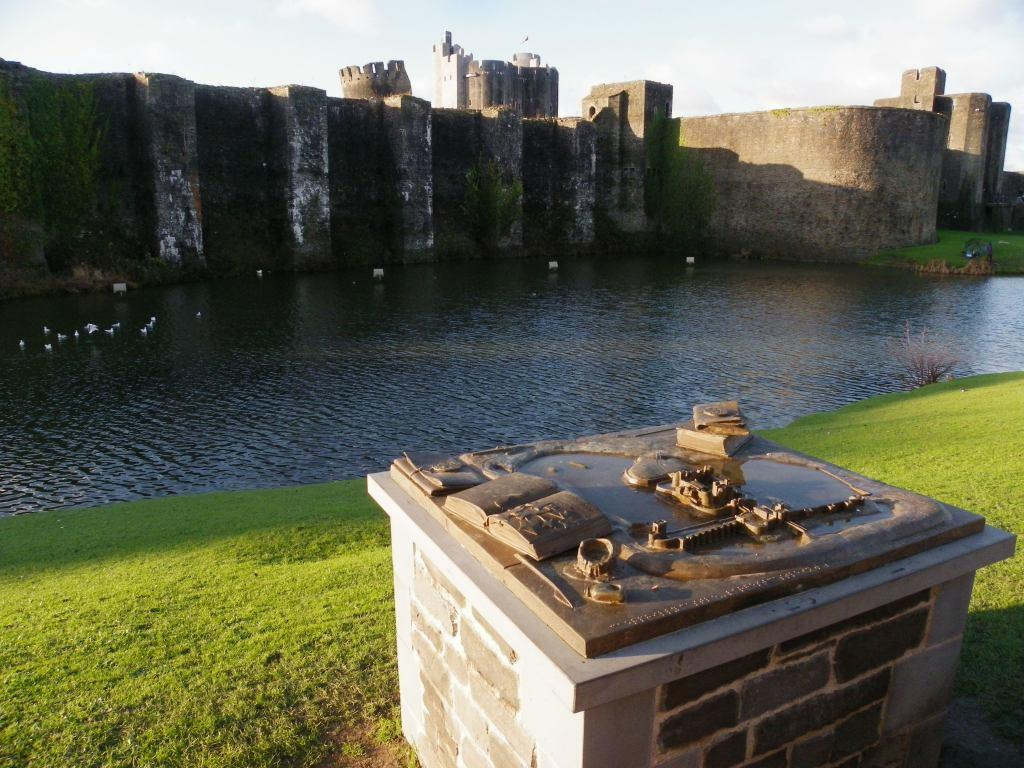Caerphilly Castle walls, plaque and moat