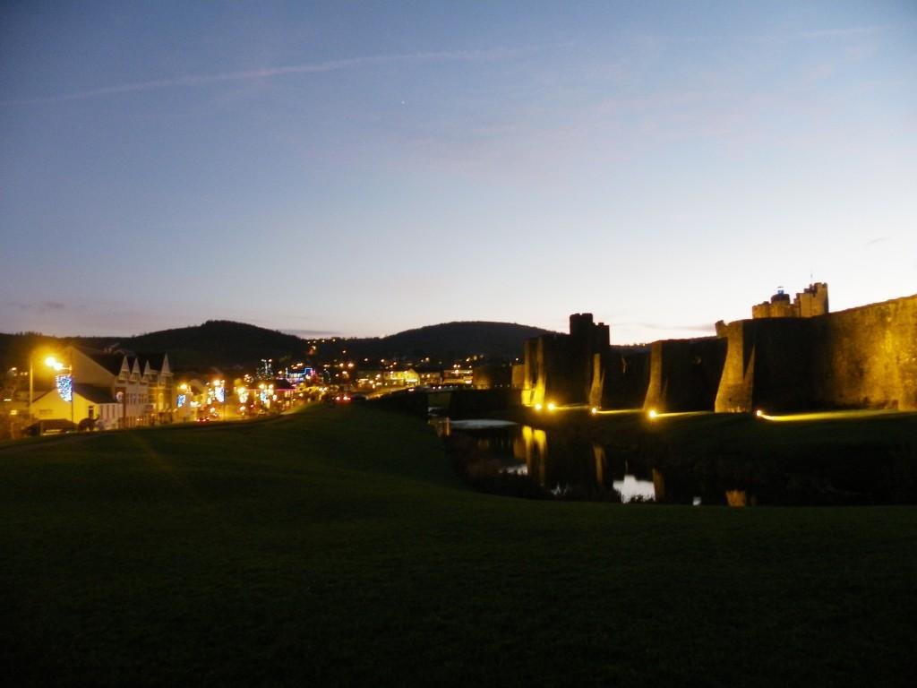 Caerphilly Castle ramparts and Caerphilly town floodlit at night