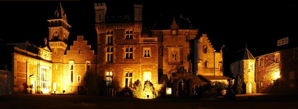 Dog Friendly Hotel Craig y Nos Castle floodlit at night