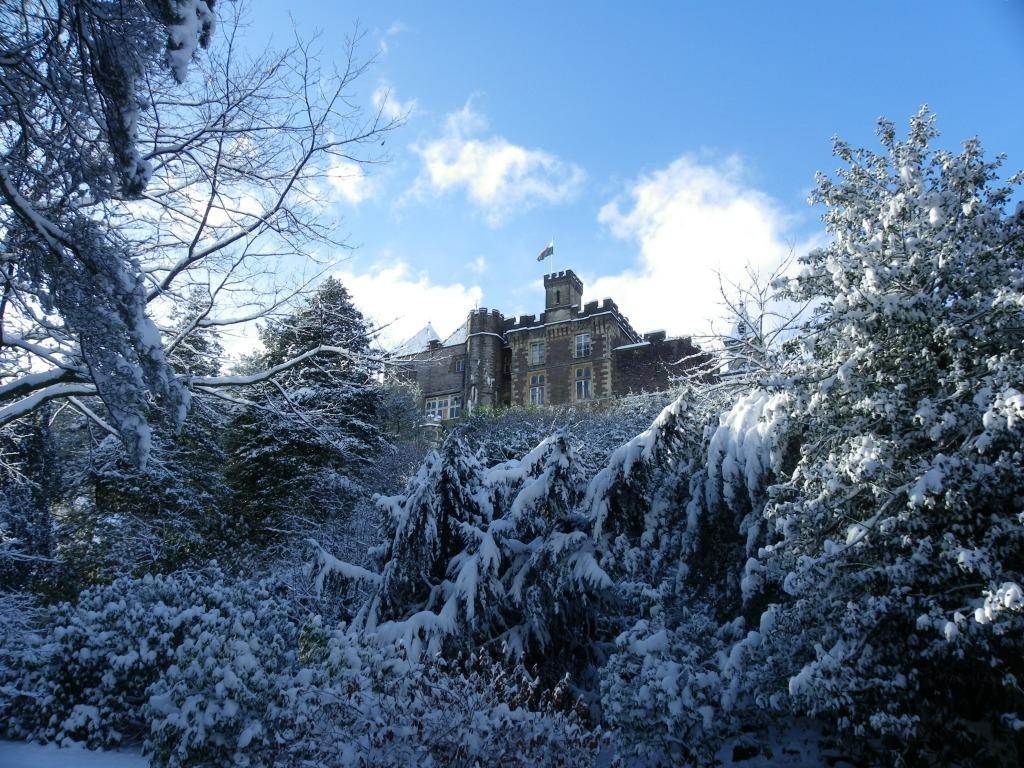 Dog Friendly Hotel in Brecon Craig y Nos Castle in snow from Lower Garden