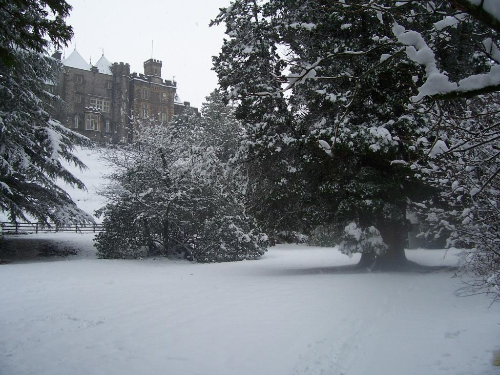 Dog Friendly Hotel in Brecon Craig y Nos Castle Lower Gardens and Castle in winter snow