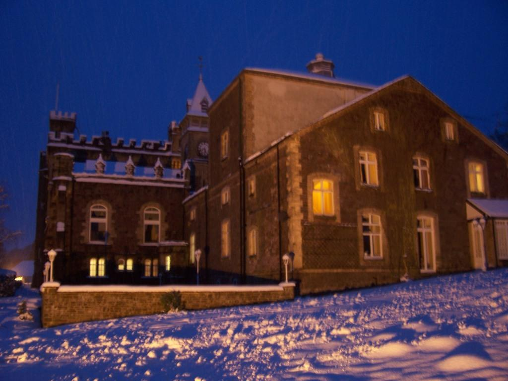 Dog Friendly Hotel Brecon back of castle and Theatre in snow floodlit at night