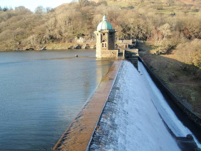 Dog walking Wales -  Elan Village Reservoirs water flowing over dam
