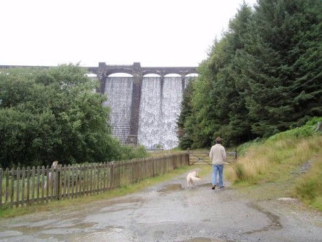 Dog walking Wales -  Elan Village Reservoirs Dam with water flowing