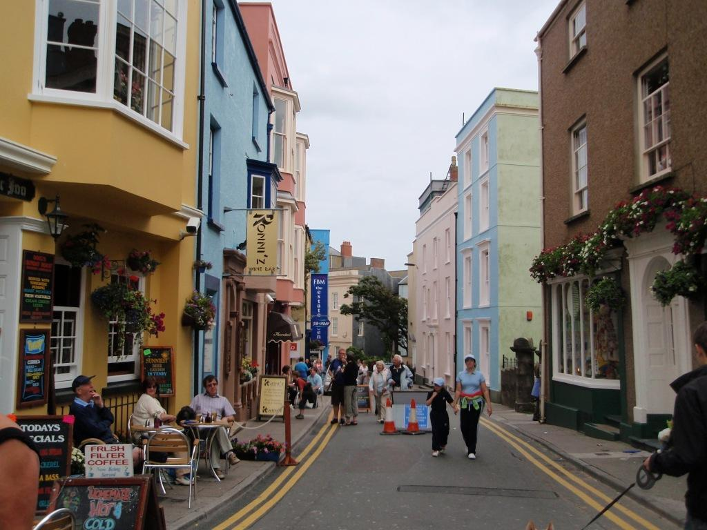 Tenby Town colourful houses and pleaant streets for people to walk and browse shops
